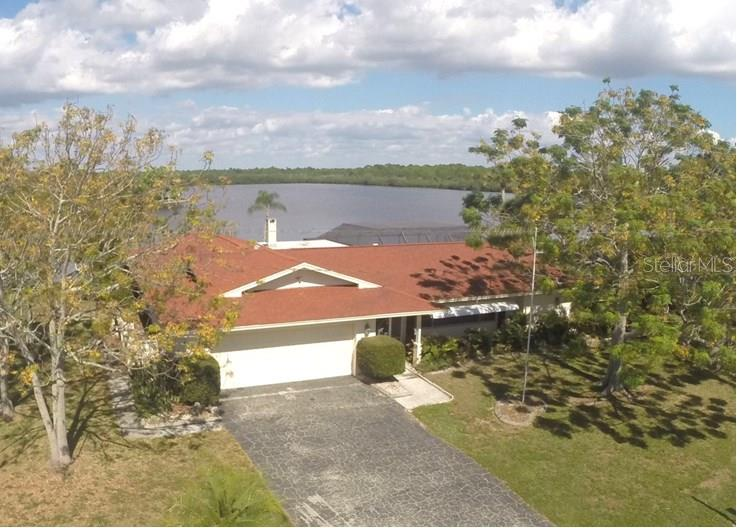 Just imagine living here with Coral Creek views like this every day! - Single Family Home for sale at 450 Coral Creek Dr, Placida, FL 33946 - MLS Number is D5901346