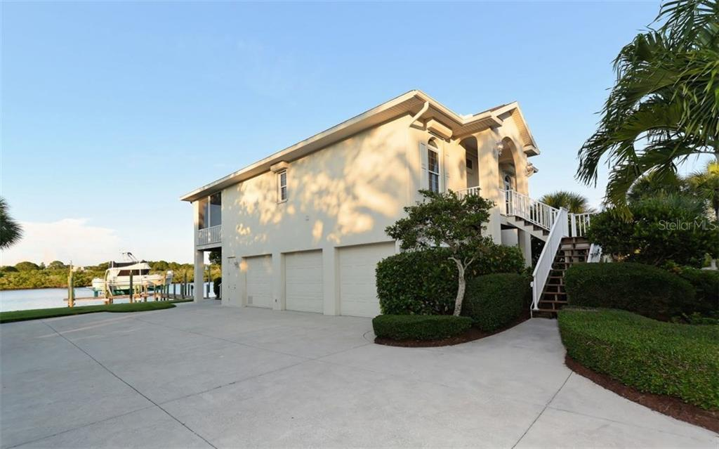 Guest House with additional 2 bedrooms, dock, 3 car garage - Single Family Home for sale at 730 N Manasota Key Rd, Englewood, FL 34223 - MLS Number is D5912725