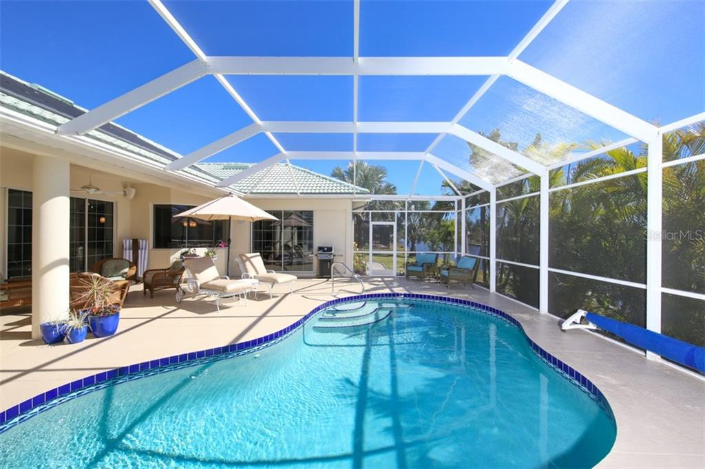Caged Pool and Lanai - Single Family Home for sale at 15794 Viscount Cir, Port Charlotte, FL 33981 - MLS Number is D5916496