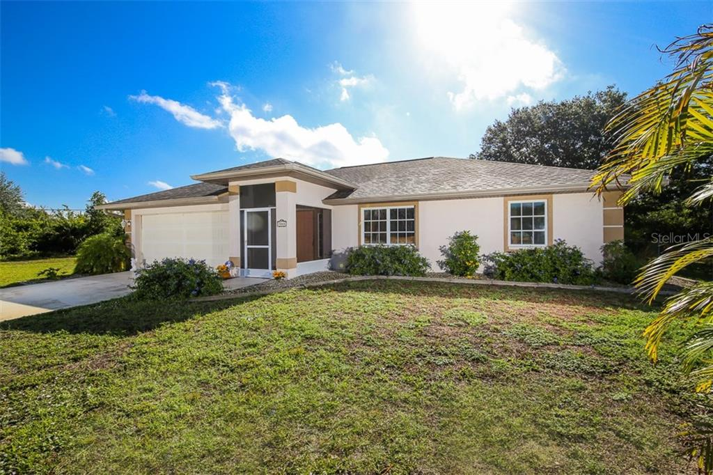 Front - Single Family Home for sale at 7044 Quigley St, Englewood, FL 34224 - MLS Number is D5918526
