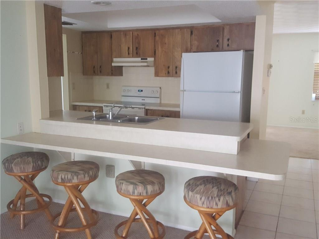 Breakfast bar and kitchen. - Single Family Home for sale at 21068 Halden Ave, Port Charlotte, FL 33952 - MLS Number is D5918749