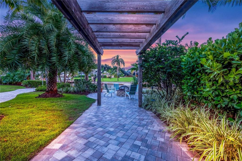 Under the pergola, paver walkways - Single Family Home for sale at 260 Capstan Dr, Cape Haze, FL 33946 - MLS Number is D5919159