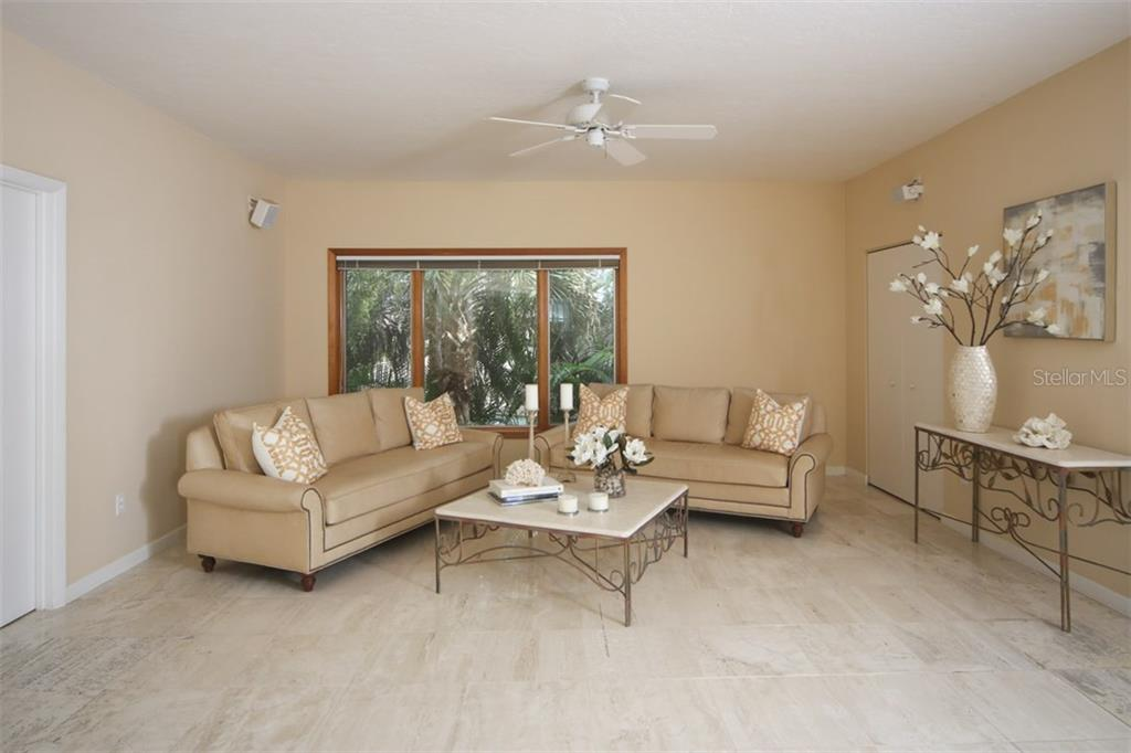Family Room - Single Family Home for sale at 1850 Bayshore Dr, Englewood, FL 34223 - MLS Number is D5919513