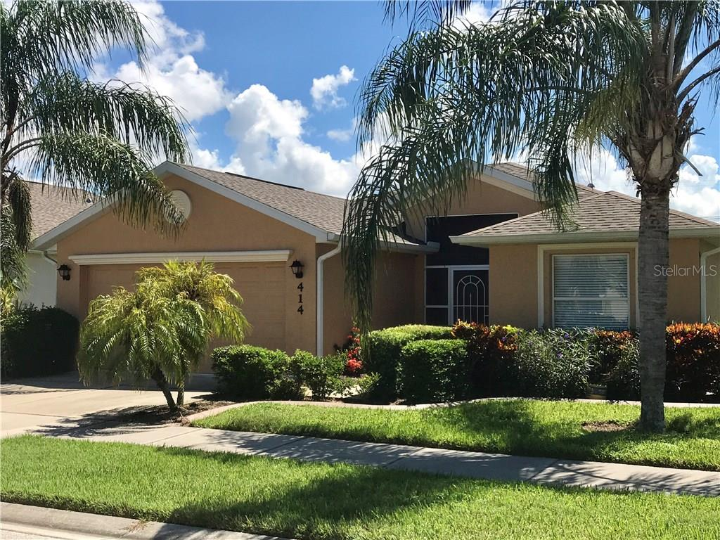 Front of home - sidewalks through out the development - Single Family Home for sale at 414 Tomoka Dr, Englewood, FL 34223 - MLS Number is D5919831