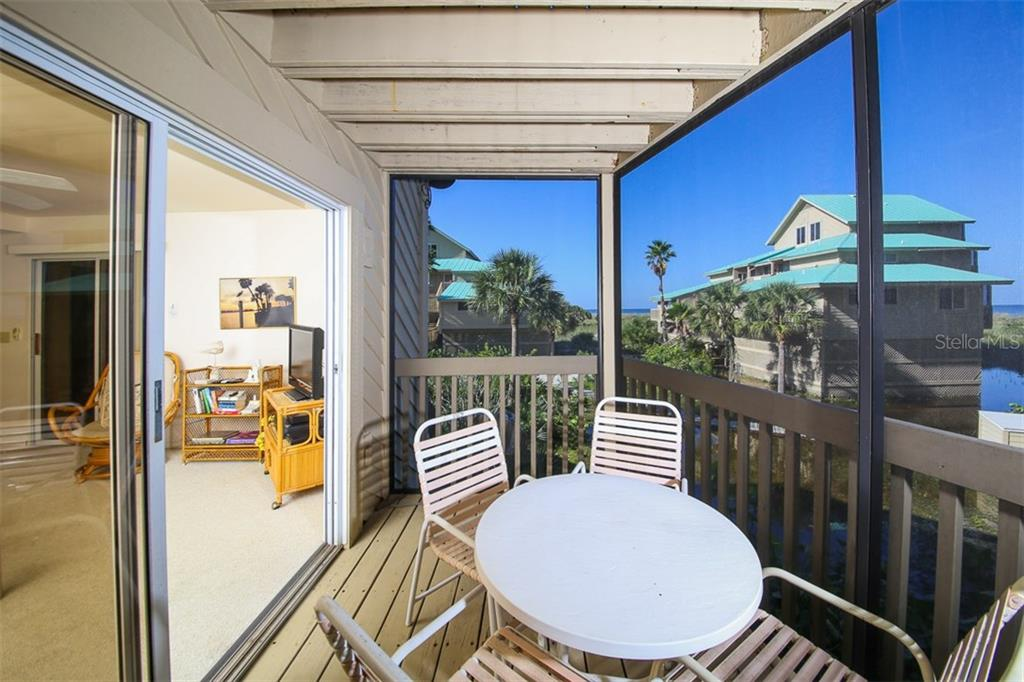 Screened porch off Living Room - Condo for sale at 9200 Little Gasparilla Is #203, Placida, FL 33946 - MLS Number is D5920072