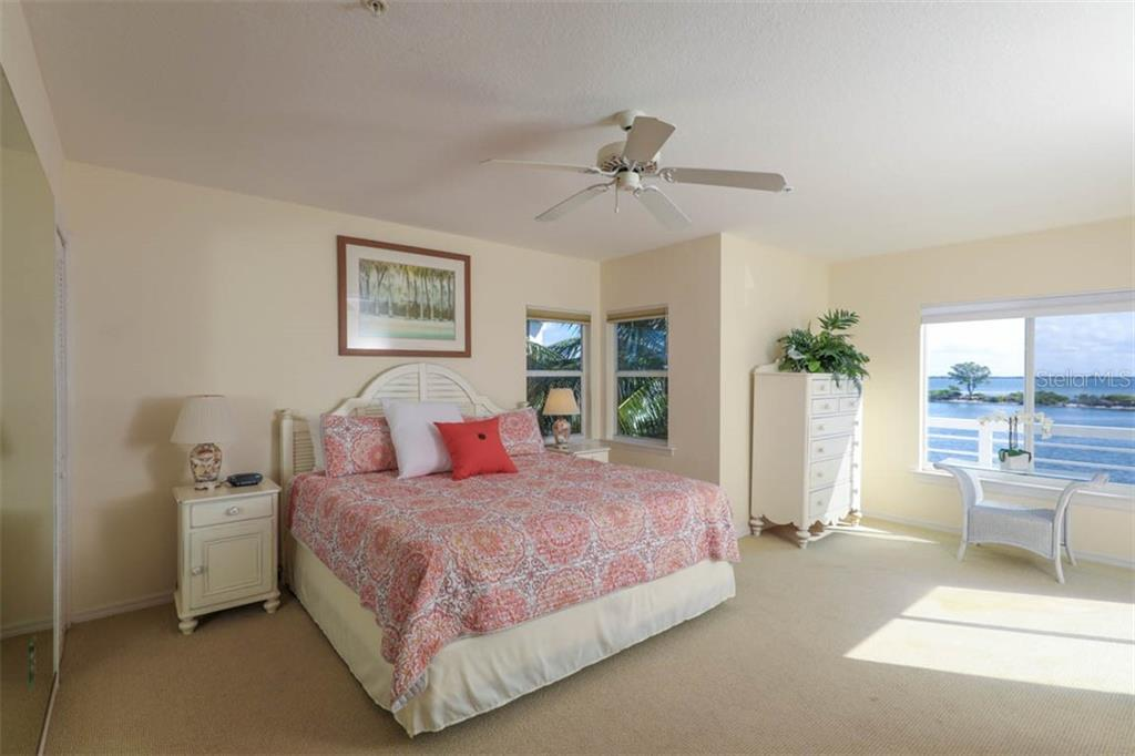 Large master bedroom with balcony - Single Family Home for sale at 16740 Grande Quay Dr, Boca Grande, FL 33921 - MLS Number is D5920860