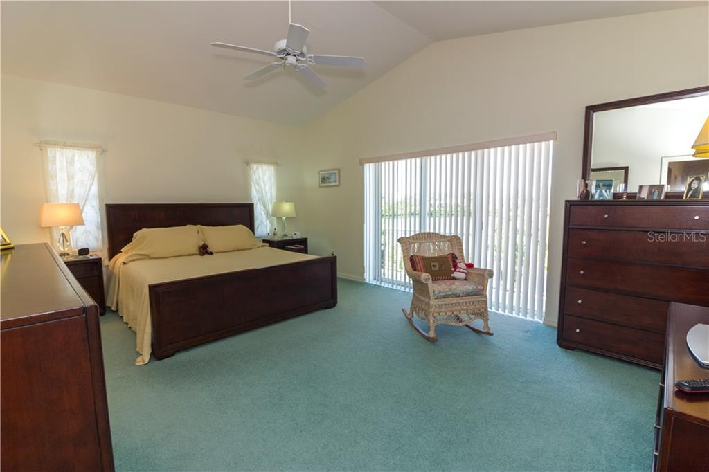 The master bedroom has a private balcony overlooking the pool and water. - Single Family Home for sale at 1439 Deer Creek Dr, Englewood, FL 34223 - MLS Number is D5921060