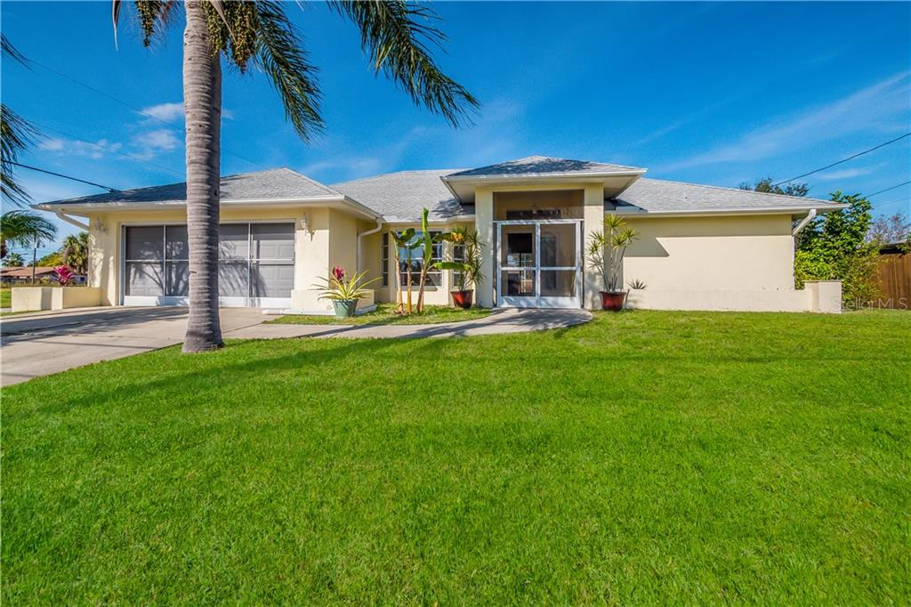 Front of home - Single Family Home for sale at 11010 Deerwood Ave, Englewood, FL 34224 - MLS Number is D5921766