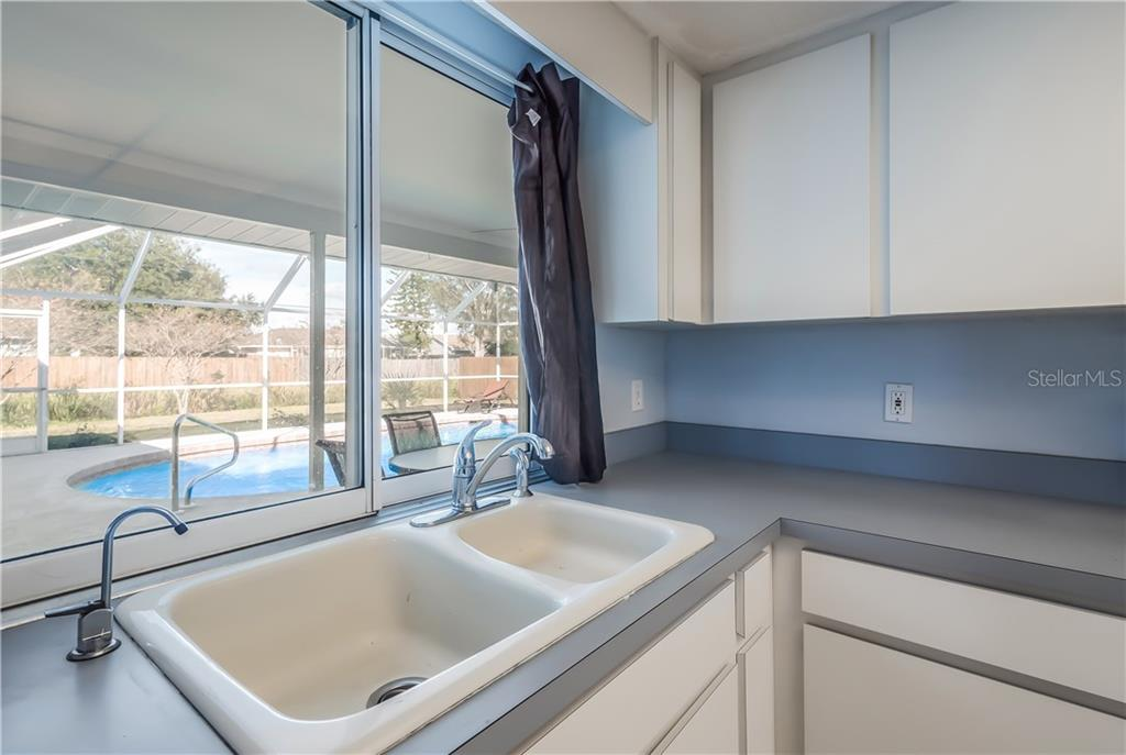 Sliding pass through window. - Single Family Home for sale at 11010 Deerwood Ave, Englewood, FL 34224 - MLS Number is D5921766