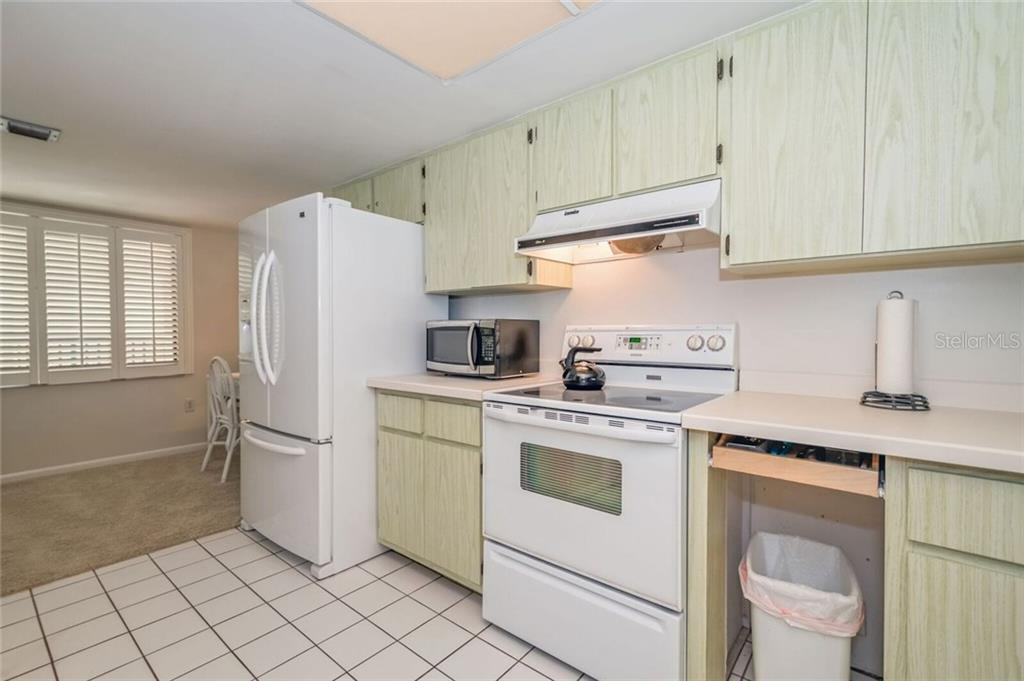 KITCHEN AND DEN AREA - Condo for sale at 5700 Gulf Shores Dr #a-215, Boca Grande, FL 33921 - MLS Number is D5922393