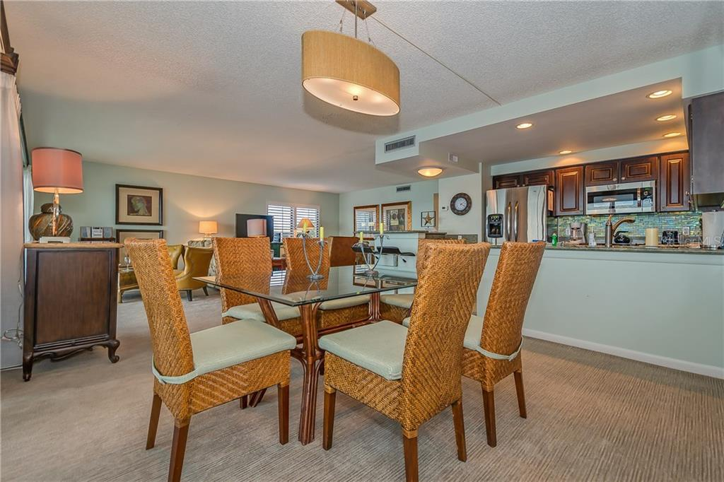 DINING,LIVING AND KITCHEN AREA - Condo for sale at 5700 Gulf Shores Dr #a-317, Boca Grande, FL 33921 - MLS Number is D5922412