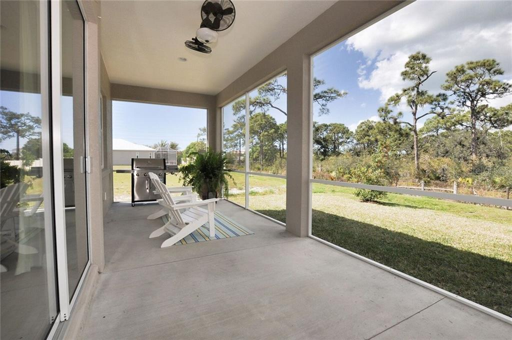 Lanai looking over the preserve - Single Family Home for sale at 8944 Scallop Way, Placida, FL 33946 - MLS Number is D5923173