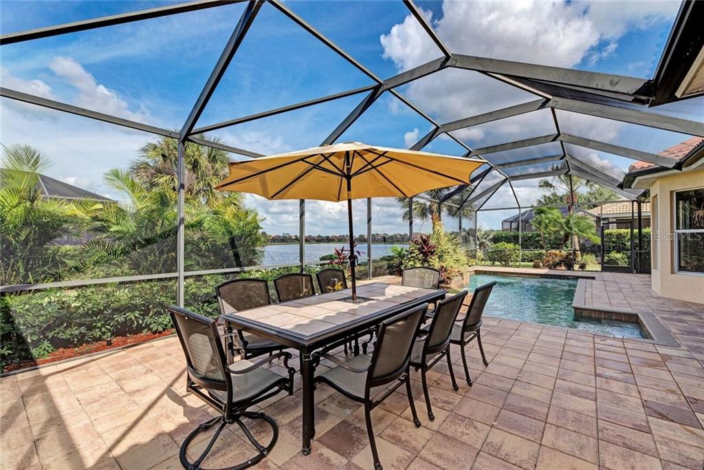 Outdoor entertaining area - Single Family Home for sale at 409 Montelluna Drive, North Venice, FL 34275 - MLS Number is D5923522