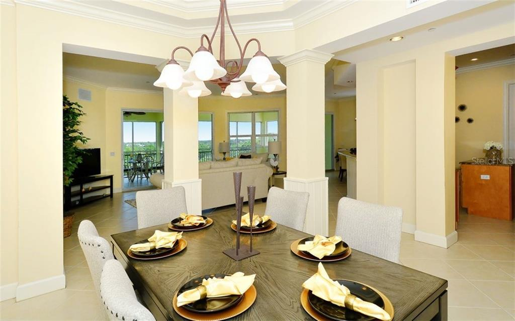 Formal Dining Open to Living space for ease of entertaining - Condo for sale at 8561 Amberjack Cir #402, Englewood, FL 34224 - MLS Number is D5923600