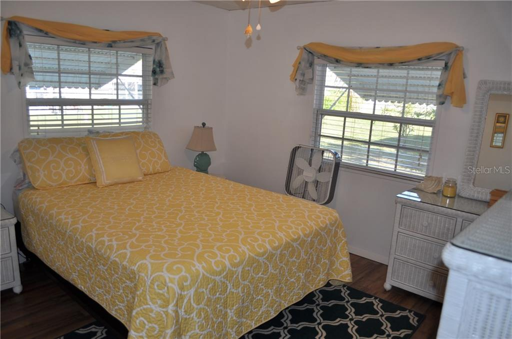 THIS IS THE 11 X 12 MASTER BEDROOM.  IT ALSO HAS THE NEW LAMINATE FLOORING. - Single Family Home for sale at 1586 Blue Heron Dr, Englewood, FL 34224 - MLS Number is D5923669