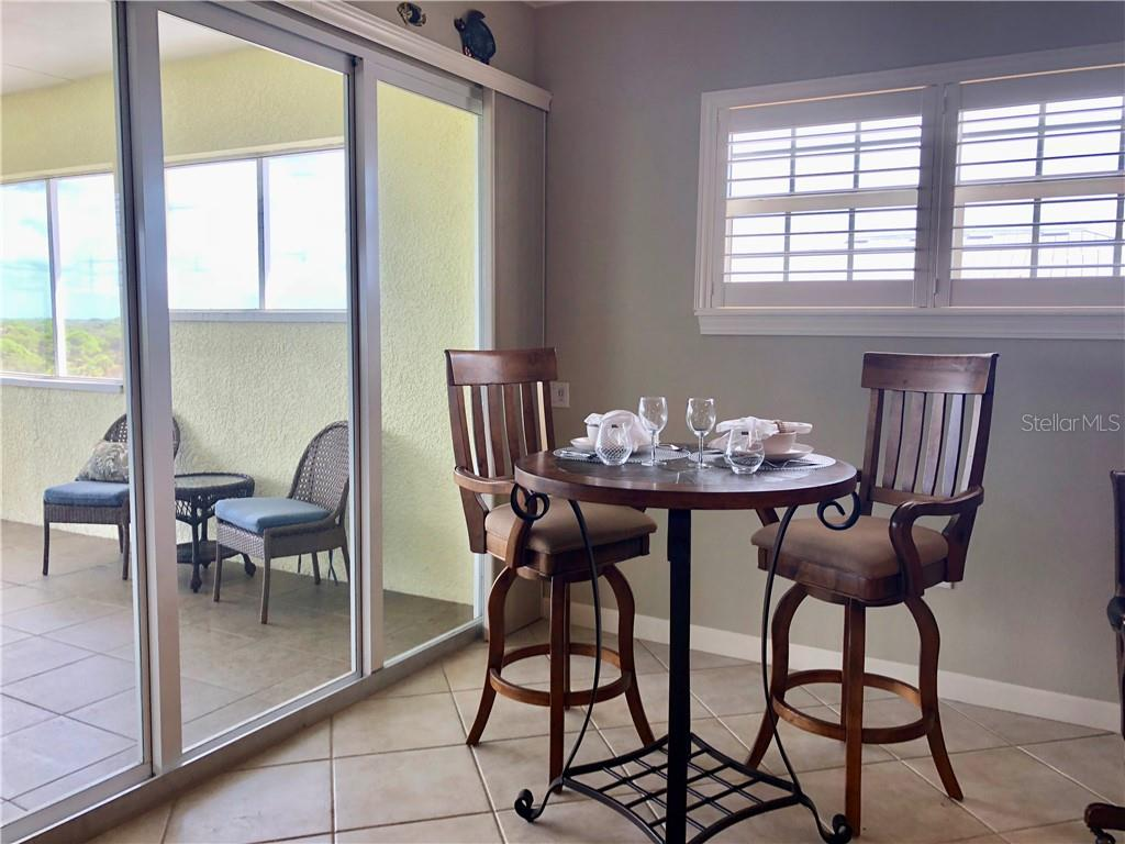 Casual dining area, with a view! - Condo for sale at 8541 Amberjack Cir #402, Englewood, FL 34224 - MLS Number is D5923680