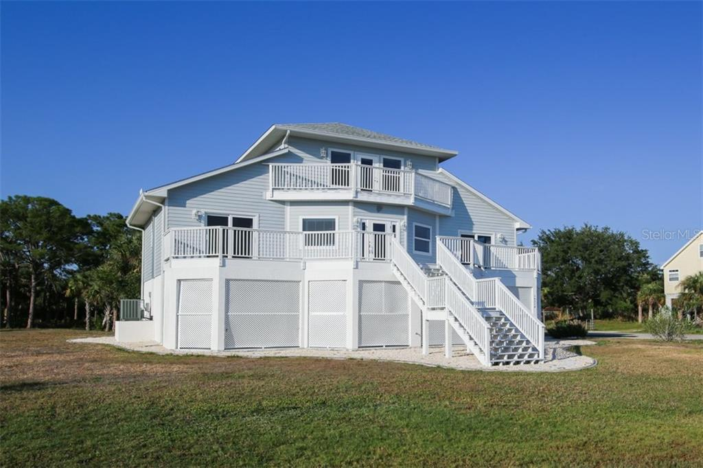 Front - Single Family Home for sale at 14241 River Beach Dr, Port Charlotte, FL 33953 - MLS Number is D5924121