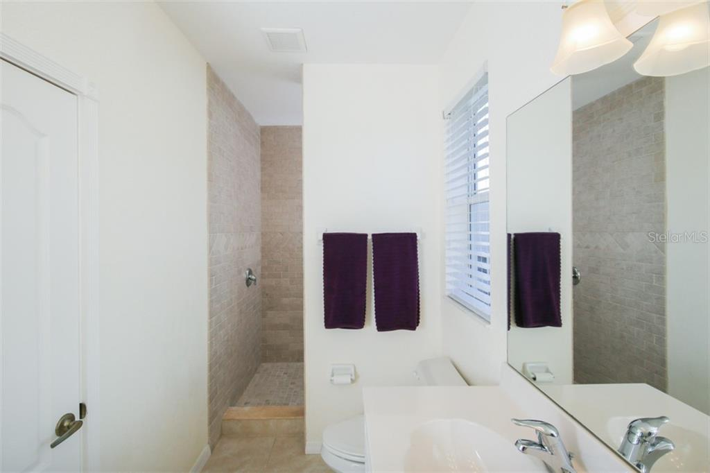 Master Bathroom with Walk in Shower - Single Family Home for sale at 14241 River Beach Dr, Port Charlotte, FL 33953 - MLS Number is D5924121
