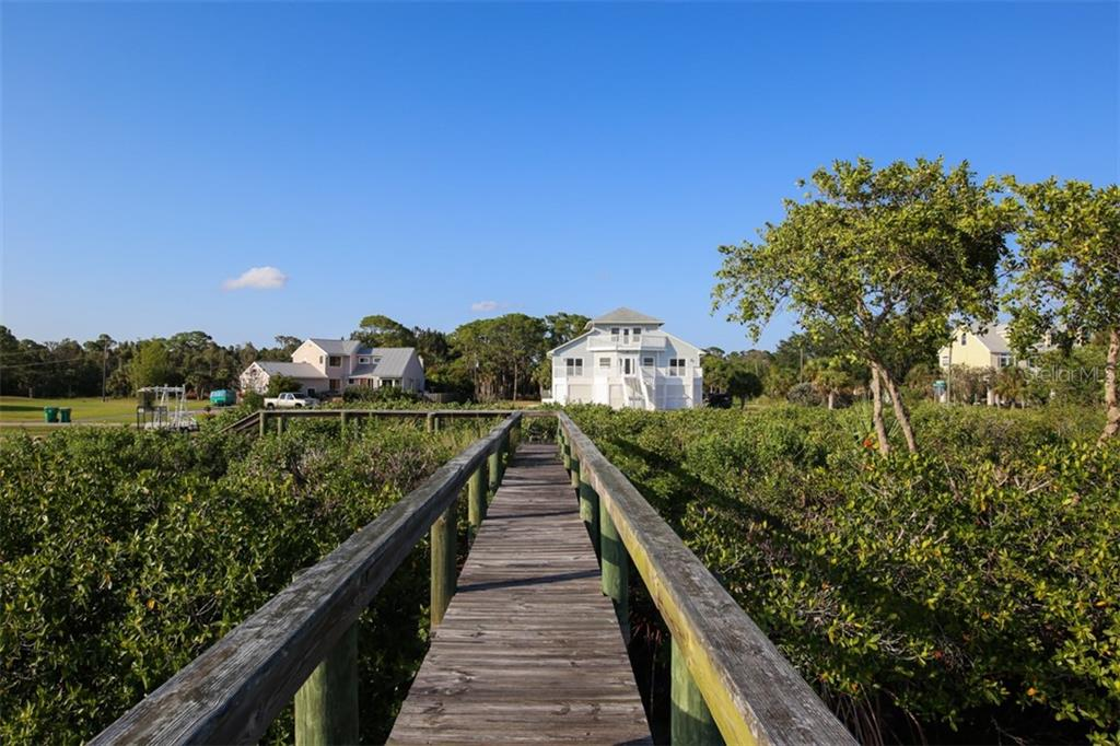 Walkway - Single Family Home for sale at 14241 River Beach Dr, Port Charlotte, FL 33953 - MLS Number is D5924121