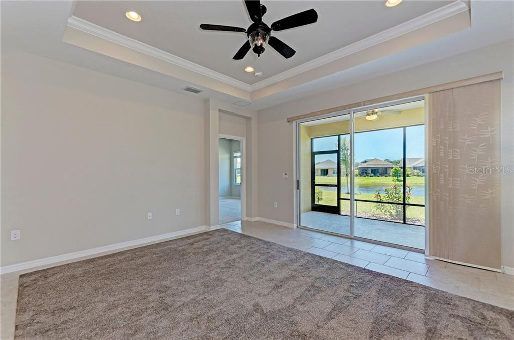 Custom blinds accent the gorgeous living area. - Single Family Home for sale at 141 Avens Dr, Nokomis, FL 34275 - MLS Number is D6100104