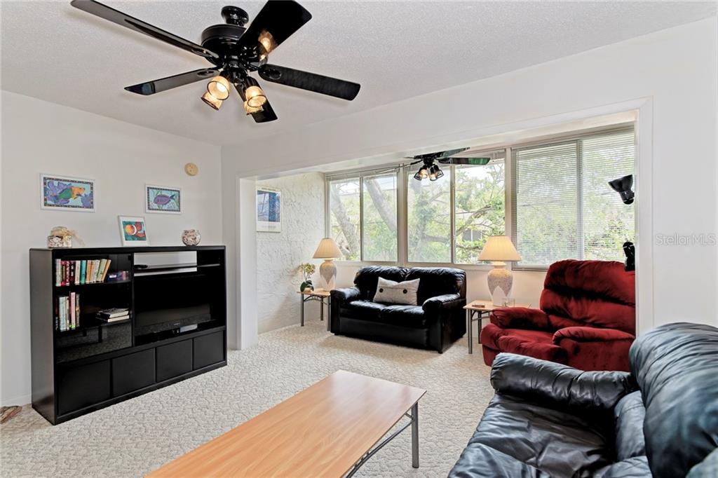 Living Room - Condo for sale at 5055 N Beach Rd #212, Englewood, FL 34223 - MLS Number is D6100243