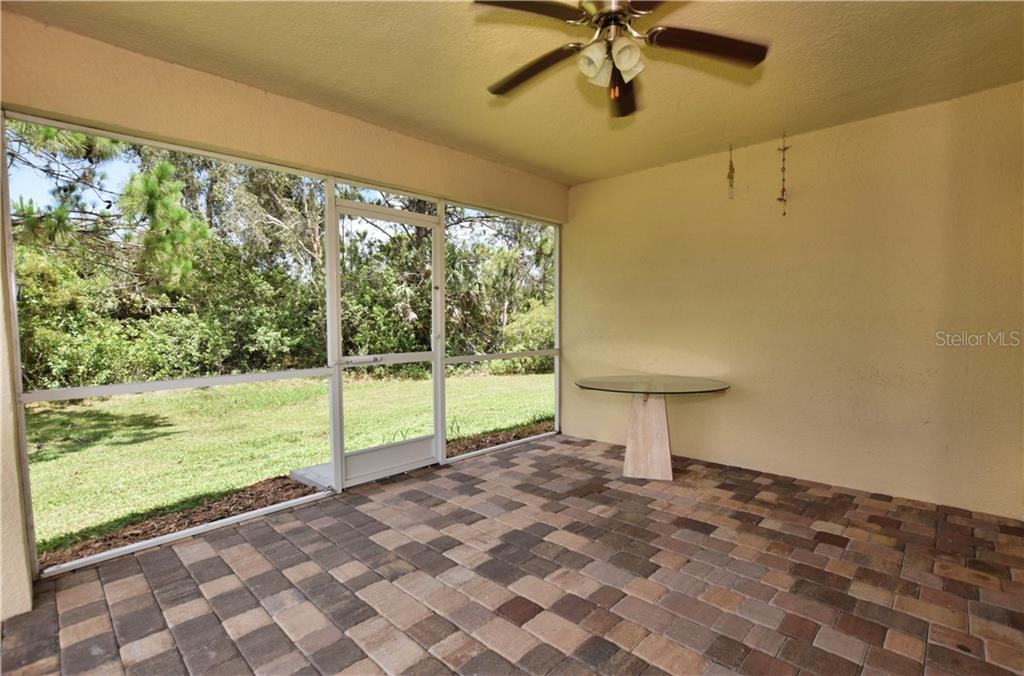 Screened in Lanai with paved flooring. - Single Family Home for sale at 4414 Callaway St, Port Charlotte, FL 33981 - MLS Number is D6100799