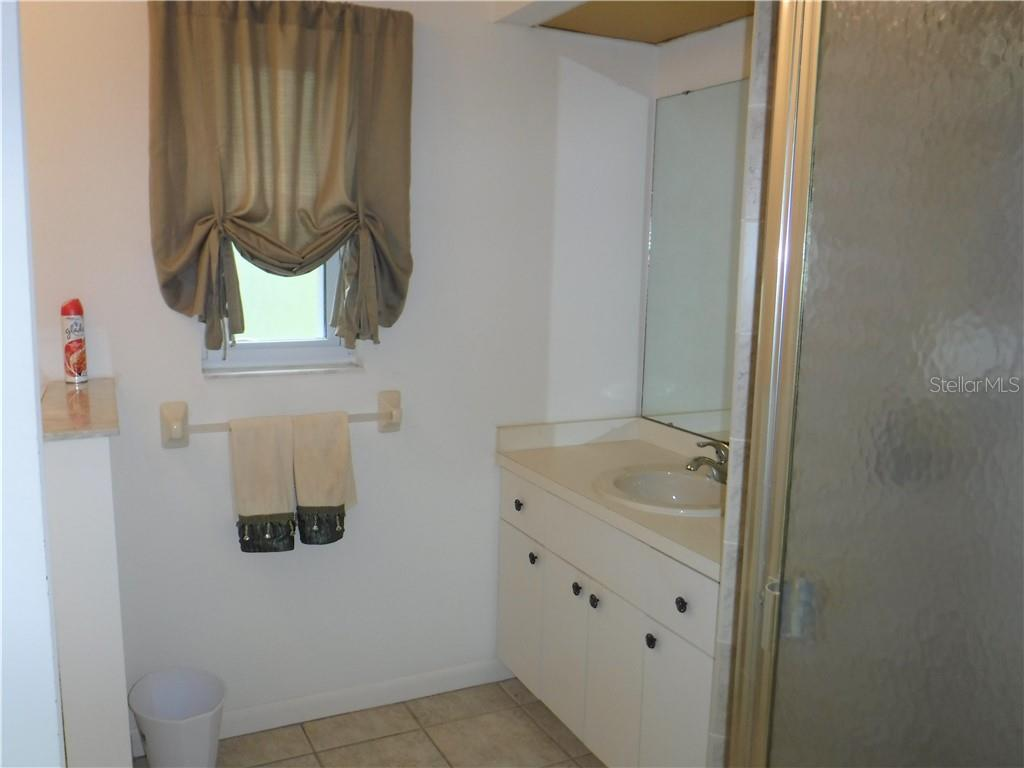 Other vanity in the master bath.  Toilet is to left. - Single Family Home for sale at 3001 Pellam Blvd, Port Charlotte, FL 33948 - MLS Number is D6101282