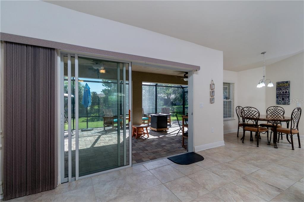Triple glass sliders open to enlarged screen and pavered lanai- perfect for entertaining and relaxing. - Single Family Home for sale at 71 Mariner Ln, Rotonda West, FL 33947 - MLS Number is D6101950