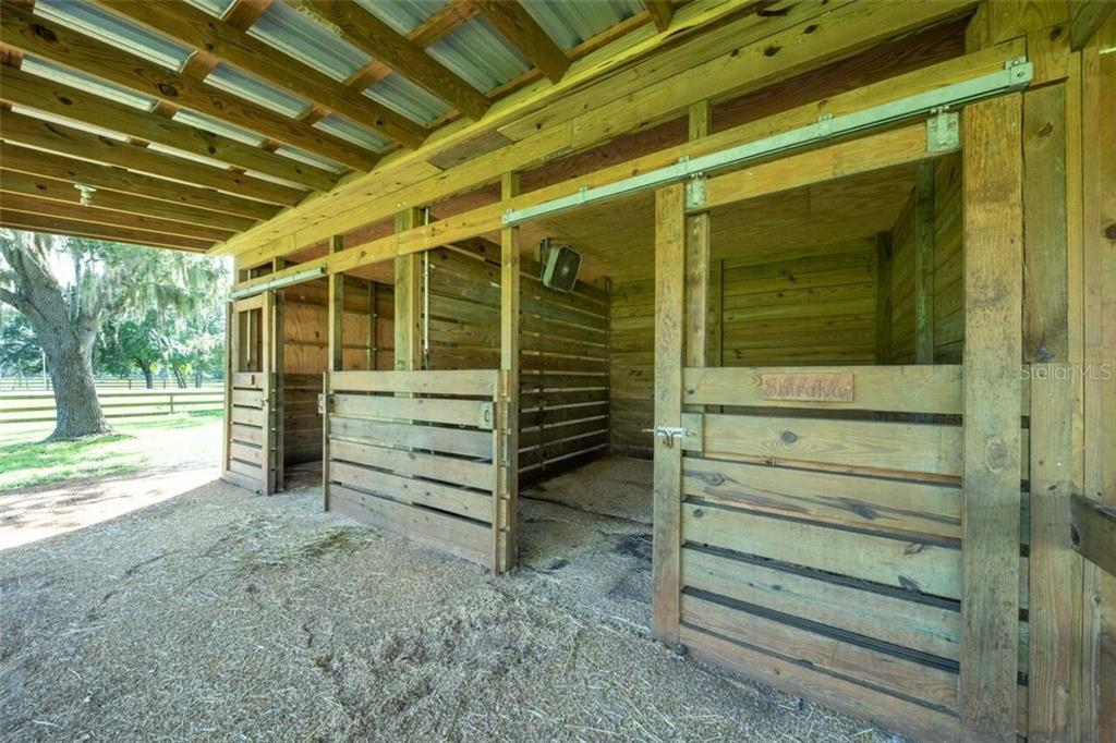 The barn has 2 spacious horse stalls with fans, lights, rubber stall mats and water - Single Family Home for sale at 7339 Hawkins Rd, Sarasota, FL 34241 - MLS Number is D6102762