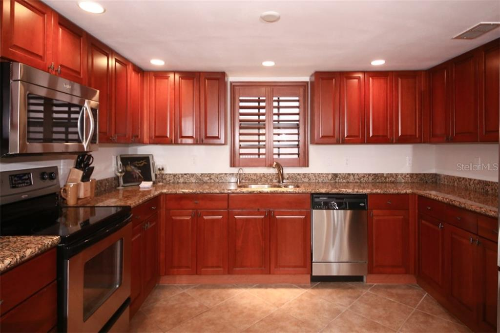 Large Kitchen With Stainless Steel Appliance - Condo for sale at 50 Meredith Dr #8, Englewood, FL 34223 - MLS Number is D6103644