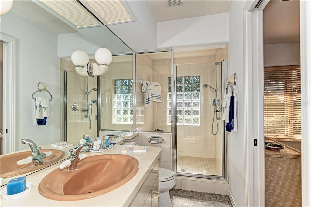 Each bedroom has its own bath. - Single Family Home for sale at 7400 Manasota Key Rd, Englewood, FL 34223 - MLS Number is D6104362
