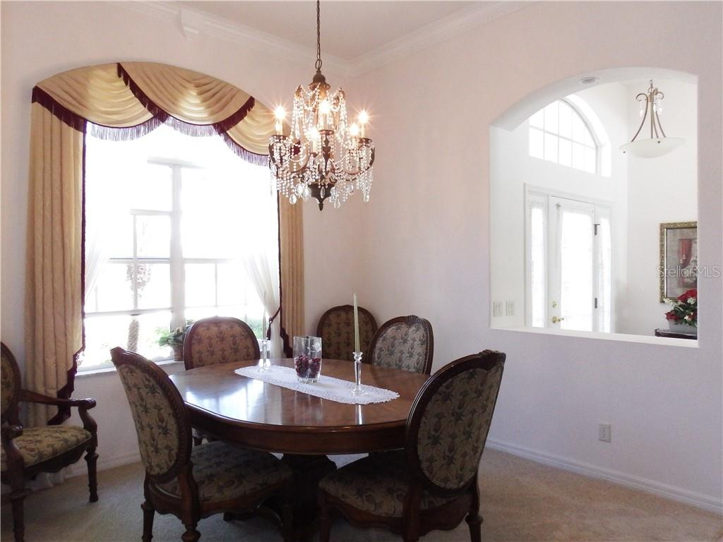 Formal dining room at the front of the home. - Single Family Home for sale at 8 Medalist Cir, Rotonda West, FL 33947 - MLS Number is D6104474