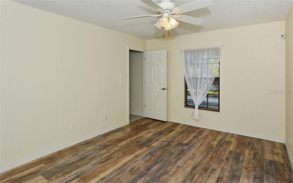 Master Bedroom with new flooring - Single Family Home for sale at 5376 Ashwood Rd, Port Charlotte, FL 33981 - MLS Number is D6105888