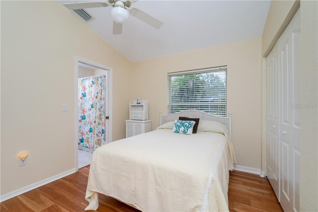 Guest bedroom 2 has vaulted ceiling, ceiling fan, wall closet and direct access to Guest bath. - Single Family Home for sale at 30 Medalist Way, Rotonda West, FL 33947 - MLS Number is D6106239