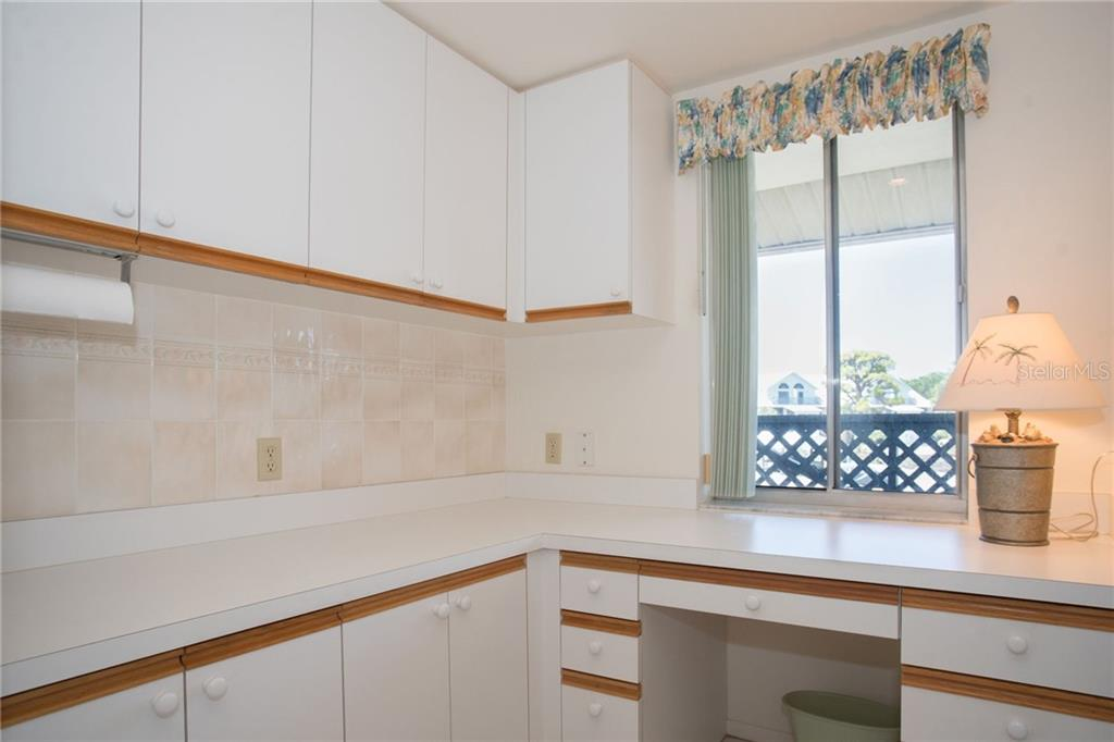 Counter space and cabinets can be used for crafts, office or kitchen storage. - Condo for sale at 6800 Placida Rd #271, Englewood, FL 34224 - MLS Number is D6106459