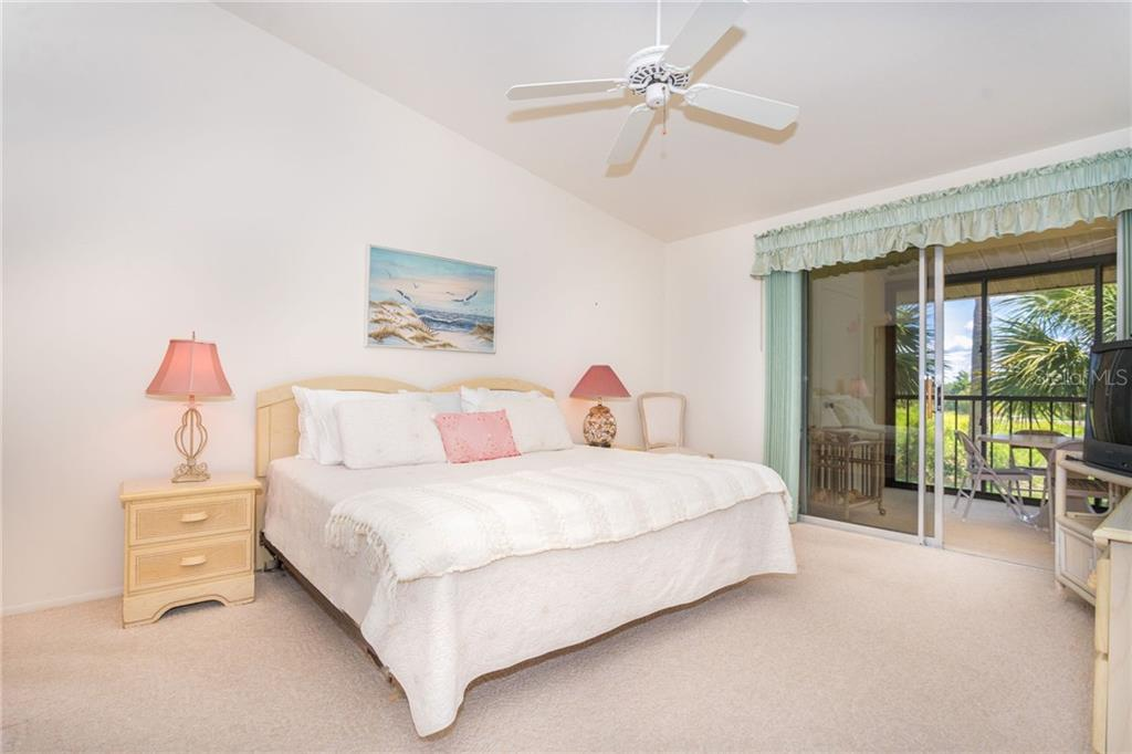 The master bedroom has enough space for a king sized bed and more! Great view and access to the screened lanai. - Condo for sale at 6800 Placida Rd #271, Englewood, FL 34224 - MLS Number is D6106459