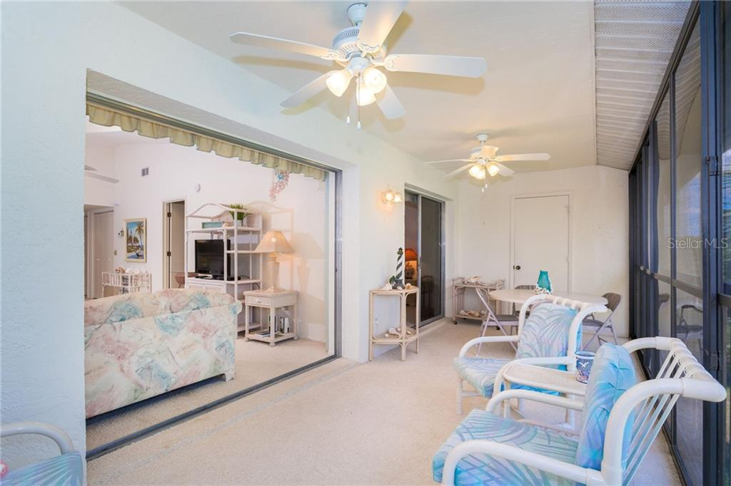 Sliding door pockets out of the way to allow a more open area. - Condo for sale at 6800 Placida Rd #271, Englewood, FL 34224 - MLS Number is D6106459