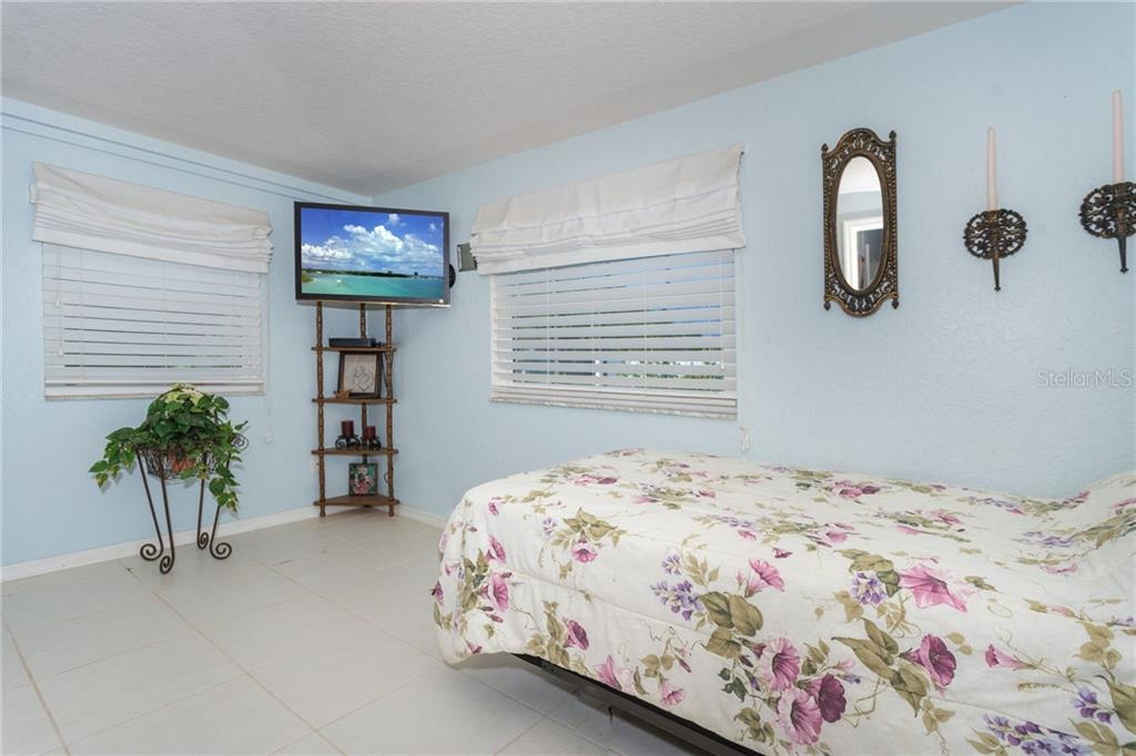 room with attached bathroom - Single Family Home for sale at 190 W Wentworth St, Englewood, FL 34223 - MLS Number is D6106918