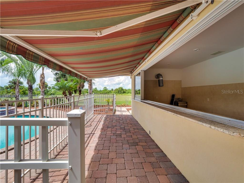 The outdoor kitchen area - Single Family Home for sale at 13283 Eisenhower Dr, Port Charlotte, FL 33953 - MLS Number is D6107998
