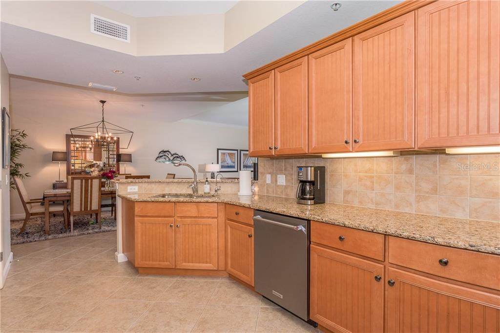 Warm wood cabinets and plenty of storage - Condo for sale at 8561 Amberjack Cir #202, Englewood, FL 34224 - MLS Number is D6109771