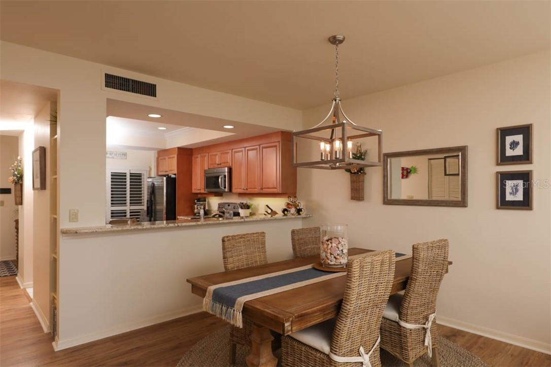 Dining Room-Kitchen - Condo for sale at 11000 Placida Rd #306, Placida, FL 33946 - MLS Number is D6110298