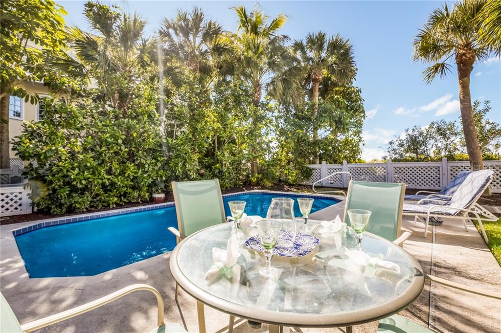 Al fresco dining by the pool - Single Family Home for sale at 16430 Gulf Shores Dr, Boca Grande, FL 33921 - MLS Number is D6110580