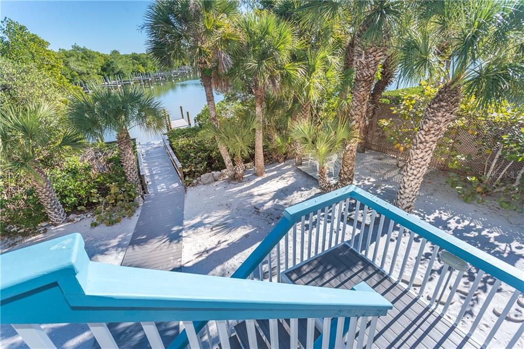 View from Rear Deck of Property and Dock. - Single Family Home for sale at 540 N Gulf Blvd, Placida, FL 33946 - MLS Number is D6110801