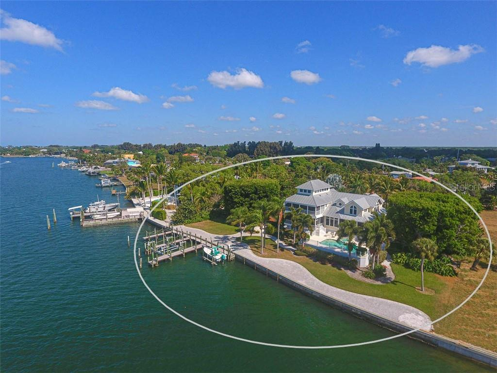 AMAZING CUSTOM WATERFRONT HOME WITH 2 LIFTS AND POOL! - Single Family Home for sale at 500 Anchor Row, Placida, FL 33946 - MLS Number is D6111649