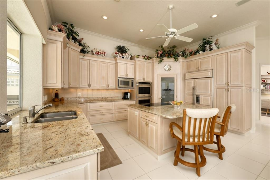 KITCHEN, WHITE WASHED MAPLE CABINETS AND GRANITE COUNTERS - Single Family Home for sale at 6793 Manasota Key Rd, Englewood, FL 34223 - MLS Number is D6112093