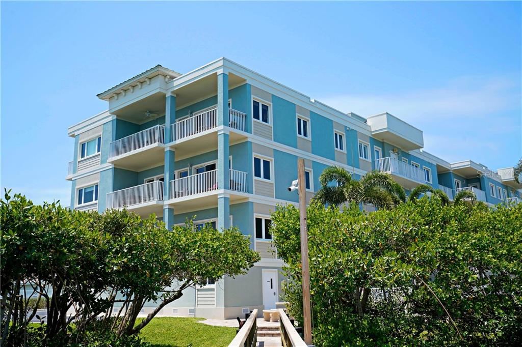 Beautiful Sunrise Point mid-rise.  This condominium overlooks the Bay.  Water views, water access and the public beach across the street are just a sample of the amenities. - Condo for sale at 2245 N Beach Rd #304, Englewood, FL 34223 - MLS Number is D6112346