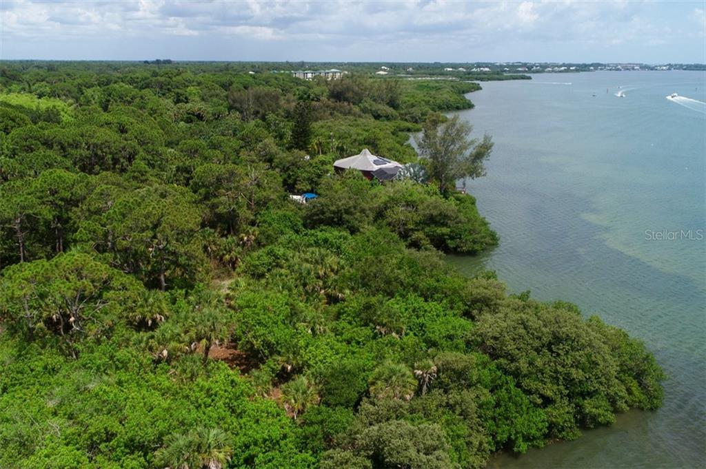 looking south on intercoastal - point belongs to property in foreground - Vacant Land for sale at 9427 Downing St, Englewood, FL 34224 - MLS Number is D6112667