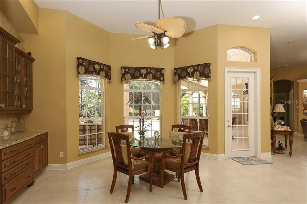 Second Dining Area Overlooks The Lanai - Single Family Home for sale at 9300 Hialeah Ter, Port Charlotte, FL 33981 - MLS Number is D6113597
