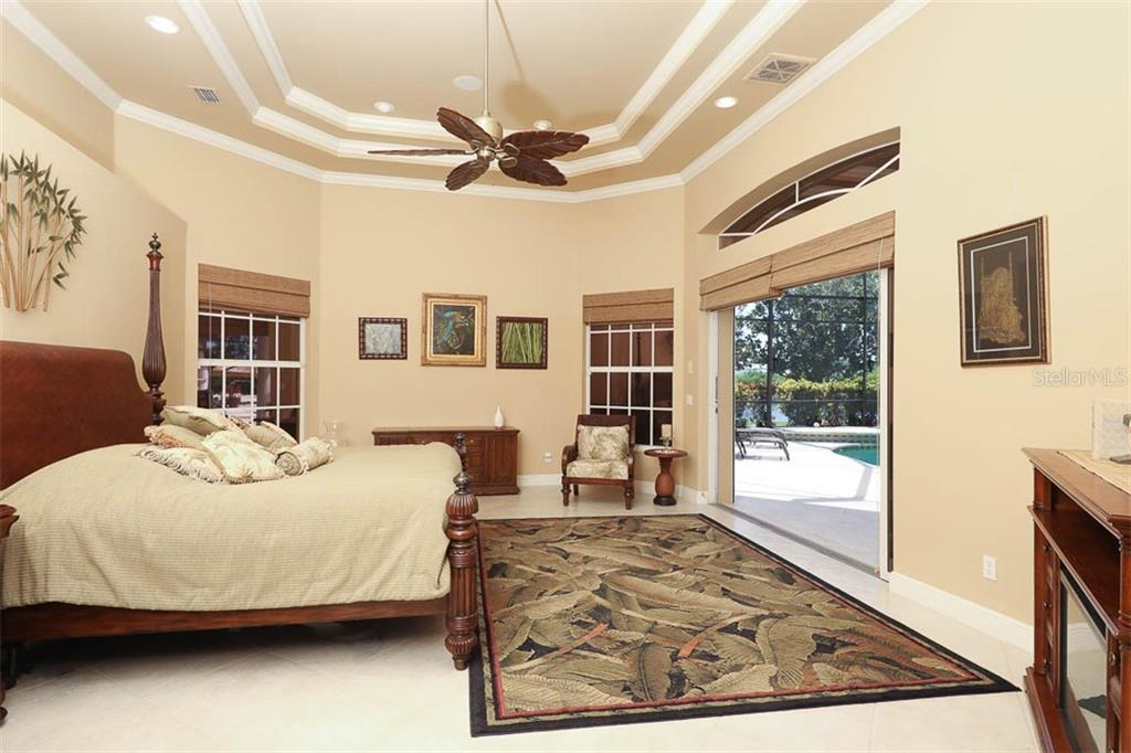 Master Bedroom Opens to Lanai & Pool - Single Family Home for sale at 9300 Hialeah Ter, Port Charlotte, FL 33981 - MLS Number is D6113597