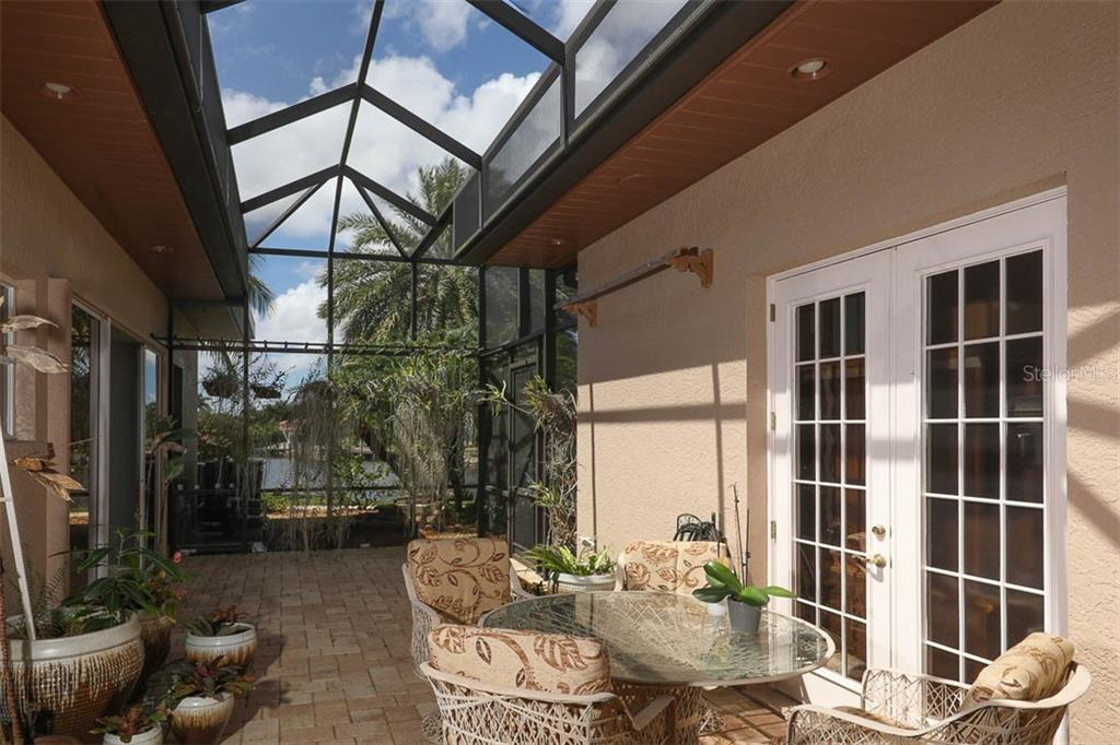 Orchid Courtyard/Lanai - Single Family Home for sale at 9300 Hialeah Ter, Port Charlotte, FL 33981 - MLS Number is D6113597